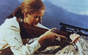 Tania Mallet as Tilly Masterson with an AR-7 survival rifle in the movie Goldfinger, 1964.