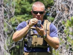 guy-with-compass-wearing-chest-rig